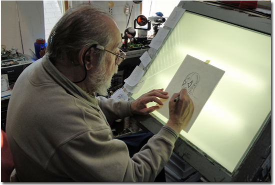 "John Fantucchio draws his ""Mysterious Character"" in his studio"